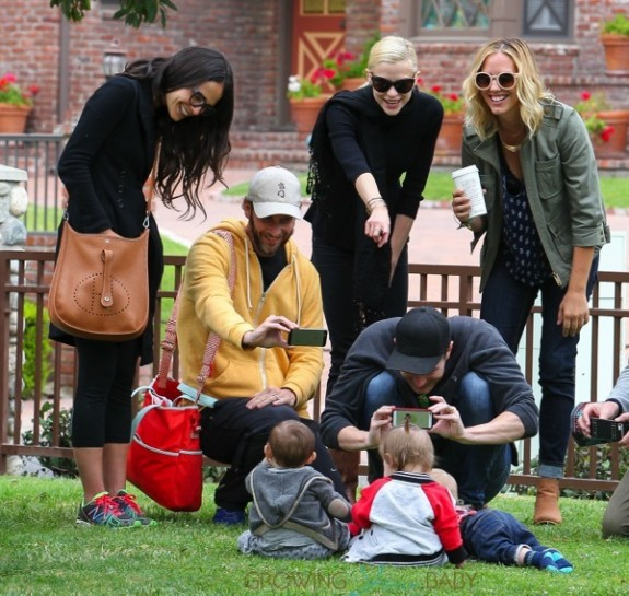 Jamie King and Jordana Brewster with their kids James and Julian at the park