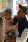 Jay Z boards a Train in  Paris with their daughter Blue