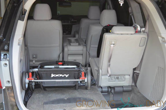 Joovy twin roo folded in the back of mini van