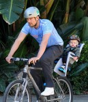 Josh Duhamel enjoys a bike ride with son AXL