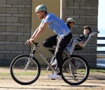 Josh Duhamel enjoys a bike ride with son AXL in Los Angeles