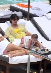 Kardashian with daughter Penelope pool side in Miami