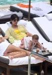 Kardashian with daughter Penelope pool side in Miami