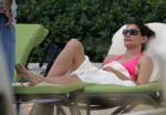 Katie Holmes Relaxes Poolside in Miami