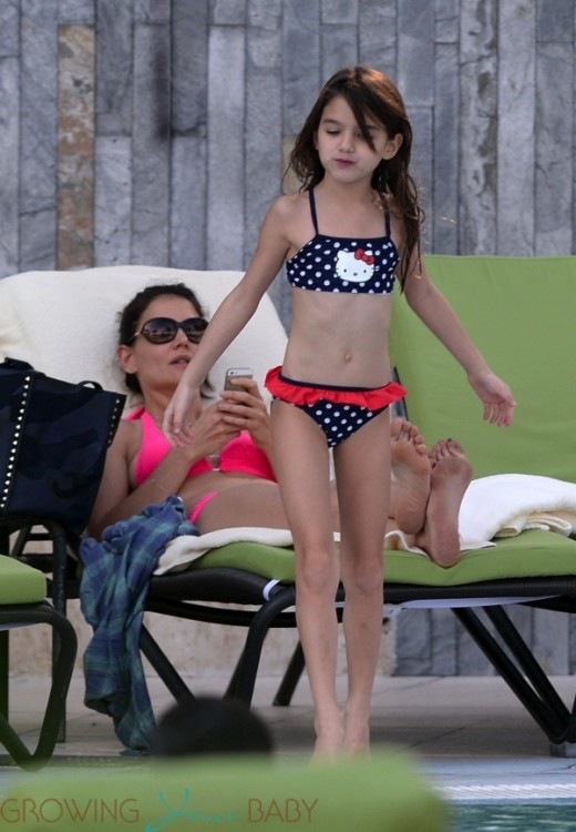 Katie Holmes and daughter Suri Cruise by the pool in Miami