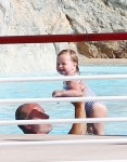 Kelsey Grammer swims with daughter Faith