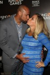 Kendra Wilkinson & husband Hank Baskett red carpet Hunger Games premiere