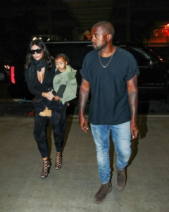 Kim Kardashian and Kanye West with daughter North West At LAX