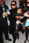 Kim Kardashian arrives at LAX with North West
