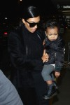 Kim Kardashian at LAX with North West