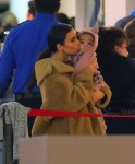 Kim Kardashian kisses baby North at JFK airport