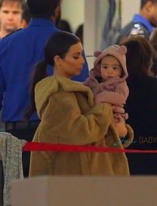 Kim Kardashian with baby North at JFK airport