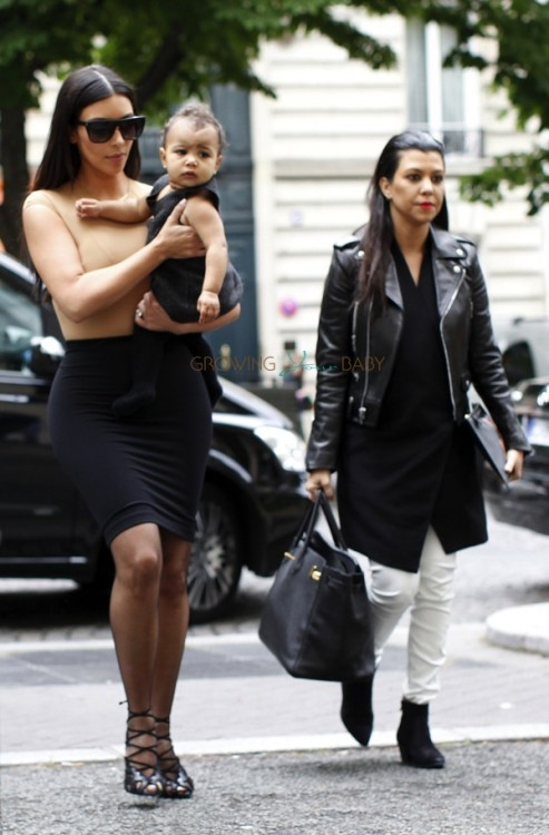 Kim Kardashian with daughter North West and sister Kourtney in Paris