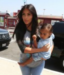 Kim Kardashian with daughter North West arrive at  Burbank airport