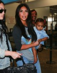 Kim Kardashian with daughter North West at Burbank airport