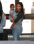 Kim Kardashian with daughter North West go through security at Burbank airport