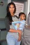 Kim Kardashian with daughter North West go through security at Burbank airport CA