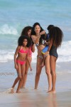 Kimora Lee Simmons plays in the ocean in St