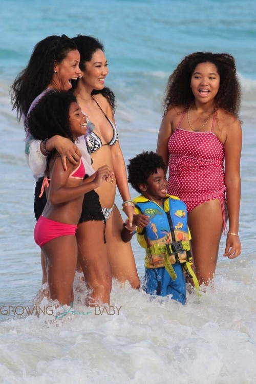Kimora Lee Simmons plays in the ocean in St. Barts with kids Kenzo, Ming and Aoki