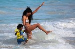 Kimora Lee Simmons plays in the ocean in St. Barts with son Kenzo