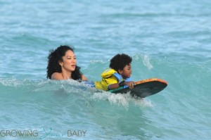 Kimora Lee Simmons plays in the ocean with son Kenzo