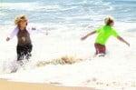 Kingston and Zuma play at the beach in Malibu