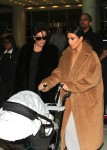 Kris Jenner and Kim Kardashian with baby North at JFK airport