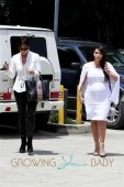 Kim Kardashian squeezes her pregnancy curves into a tight white dress as she joins 'momager' Kris Jenner for a trip to the Beauty Center in Los Angeles