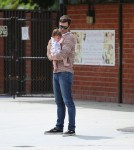Kyle Newman and with son James at the park