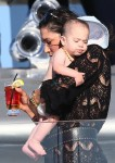 Lauren Silverman  carries her son Eric Cowell onboard a yacht in St. Tropez