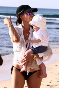Lauren Silverman strolls on the beach in Barbados with son Eric