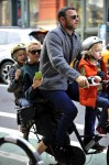 Liev Schreiber and Naomi Watts with sons Sasha and Sammy biking in NYC