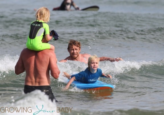 Liev Schreiber at the beach in Sydney with sons Sacha and Samuel and Simon Baker