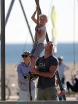 Liev Schreiber climbs the rope a the park with his son Sasha