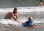 Liev Schreiber teaches his son Sasha how to surf in Australia