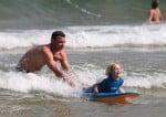 Liev Schreiber teaches his son Sasha how to surf in Australia