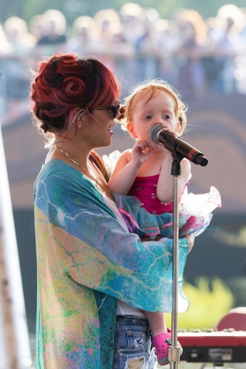Lily Allen with her daughter Marni rehearsing for Latitude Festival