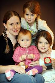 Lucy Deakin with baby Eliza and her sisters Megan and Freya