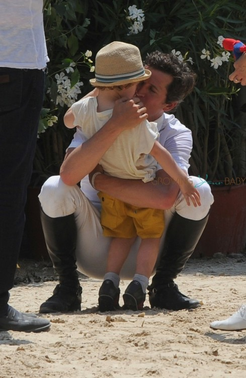 Marion Cotillard with Guillaume Canet and son Marcel at Cannes during the International show jumping