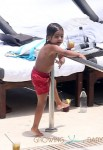 Kourtney Kardashian Shows Off Her Post-Baby Curves While Having Fun Poolside With Her Family