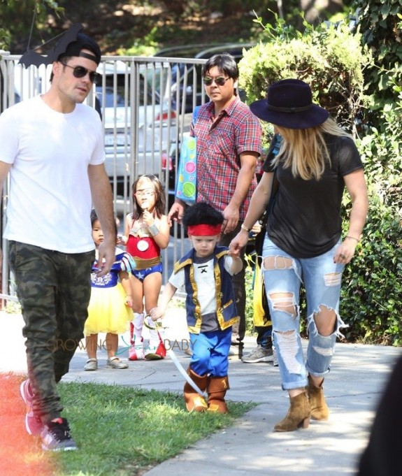 Mike Comrie and Hilary Duff with son Luca Comrie, who dressed up as a pirate for Church Halloween event
