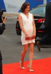 Milla Jovovich shows off her growing baby belly at the premiere  of Cymbeline