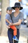 Miranda Kerr carries a very happy looking Flynn Bloom as they head home after a stroll through Central Park in New York