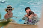 Molly Sims and Scott Stuber relax in Miami with son Brooks
