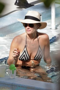 Molly Sims in the pool in Miami