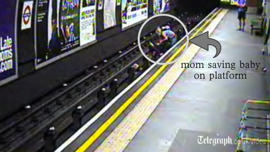 Mom saves baby on tracks after Baby's carriage blows off platform