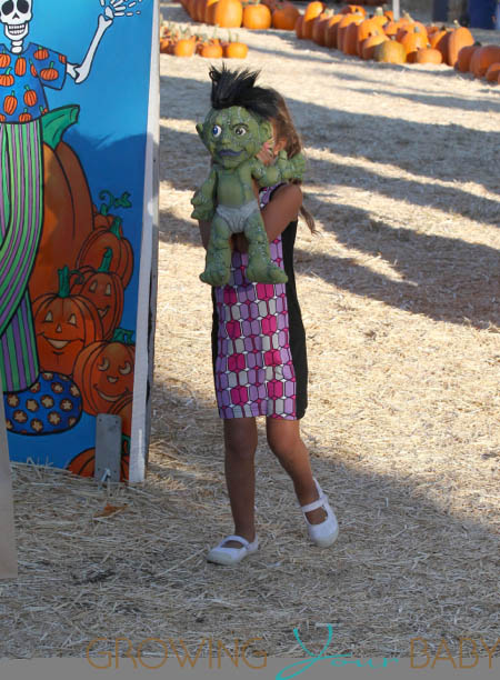 Nahla Aubry carries a martian as she leaves  at Mr. Bones Pumpkin Patch