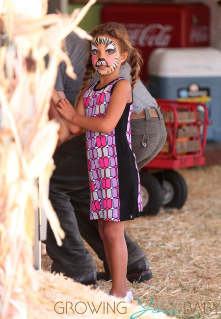 Nahla Aubry with her face painted at Mr. Bones Pumpkin Patch