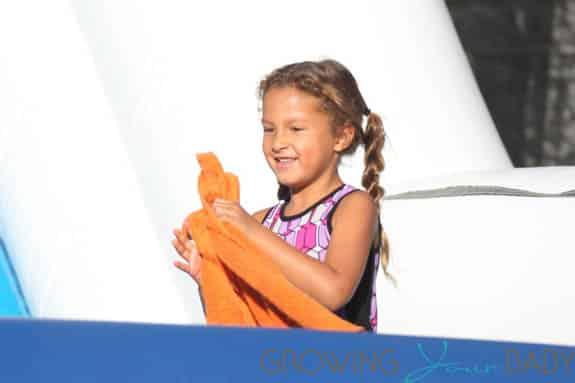 Nahla Audrey slides down the skeleton slide  at Mr. Bones Pumpkin Patch