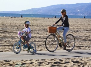 Naomi Watts bikes at the beach with her son Sammy